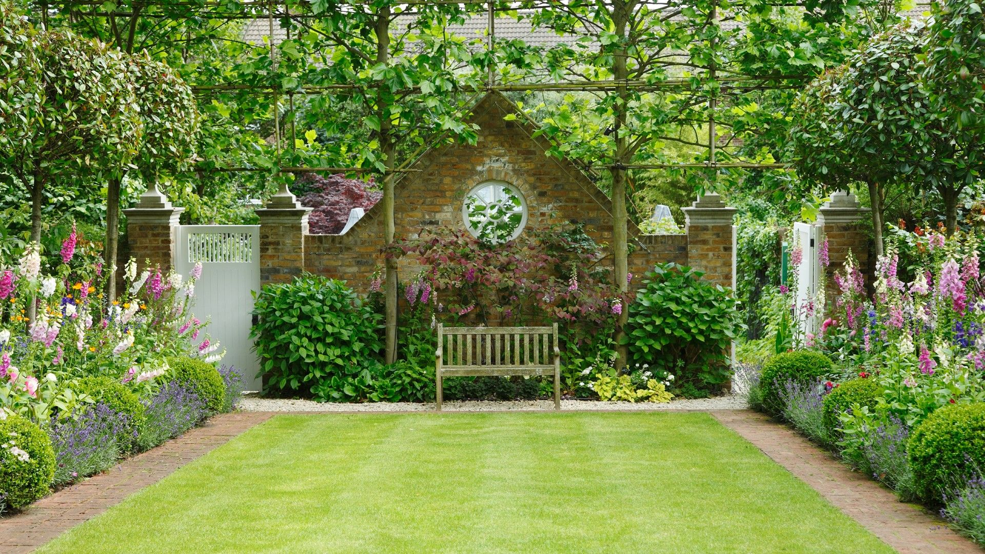 this mature formal english garden is the height of sophistication and elegance