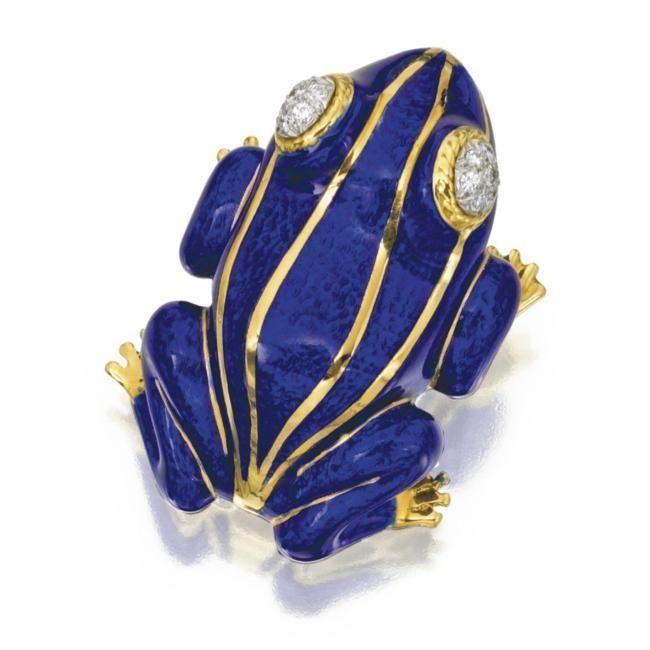 18 karat gold, platinum, diamond and enamel frog brooch, David Webb. Photo Sothebys  The eyes set with round diamonds, applied with blue enamel, signed Webb. Est. 5,000—7,000 USD. Lot Sold 6,250 USD