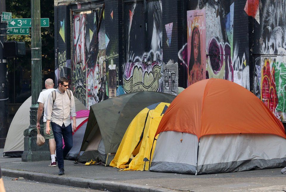 A Row Of Tents Line S Main St As Homeless Encamp On A Sidewalk In The Pioneer Square Neighborhood Of Downtown Seattle Ken Downtown Seattle Encamp Homeless