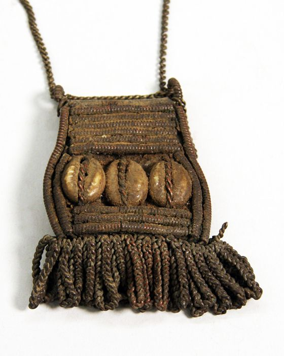 Africa | Gohu Elder's Amulet from the Giriama people of Kenya | ca. 1950 - 1978 | Hide, brass chain, brass or copper beads, and cowrie shells