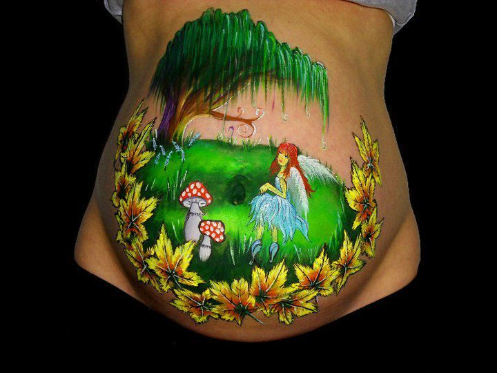 Fairytale belly paint.  Spinklesparks bodypainting.