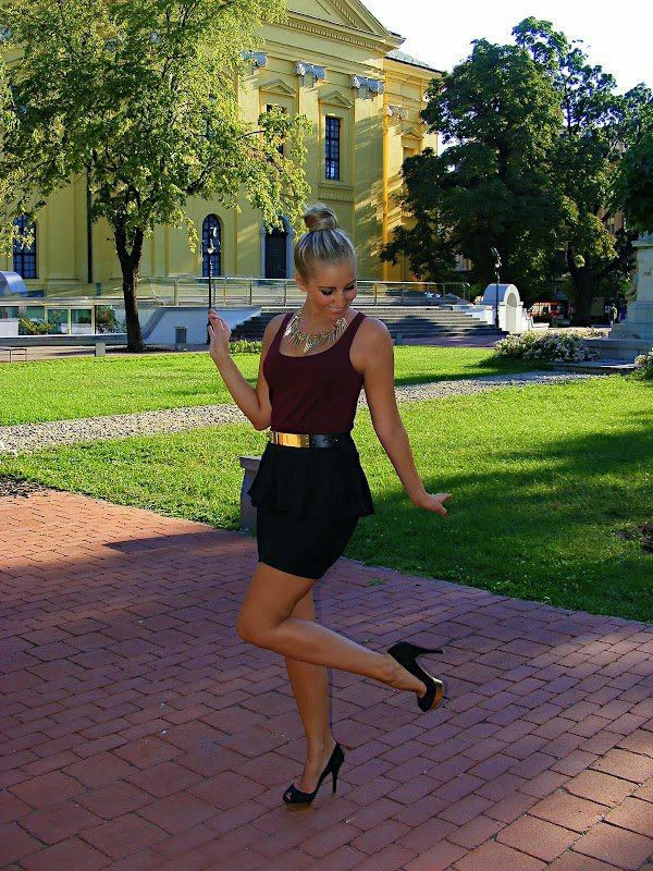 Black and burgundy peplum dress with gold accent