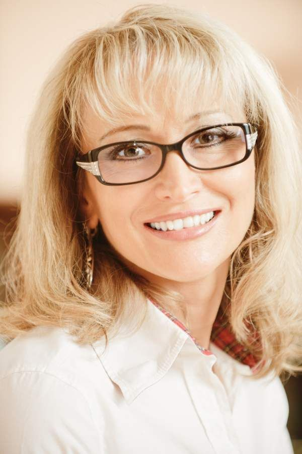 Slim mature lady with glasses