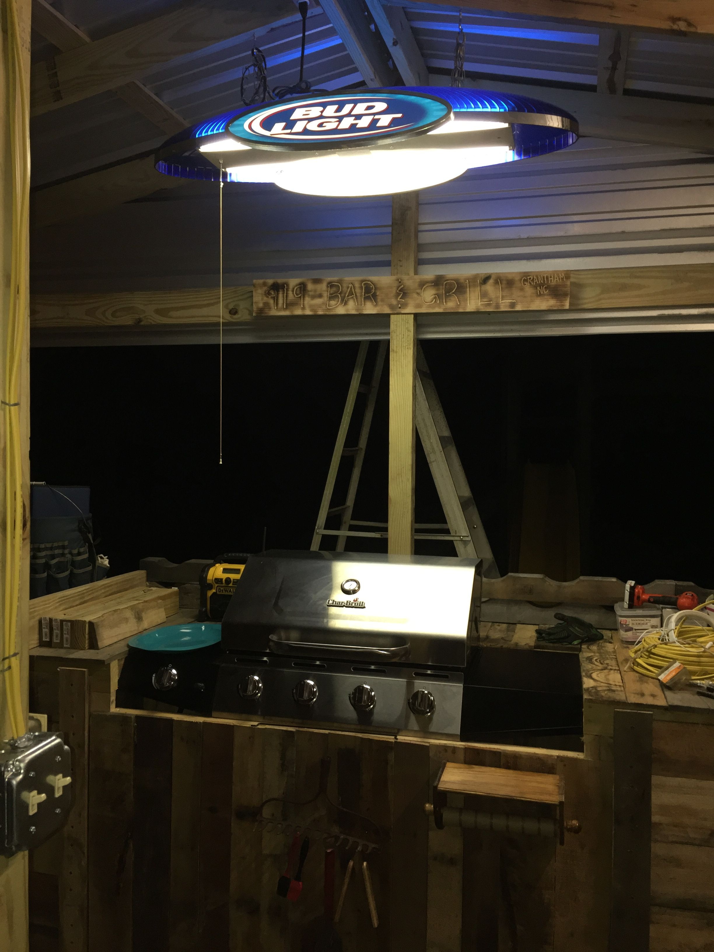 Outdoor kitchen grill and hanging light