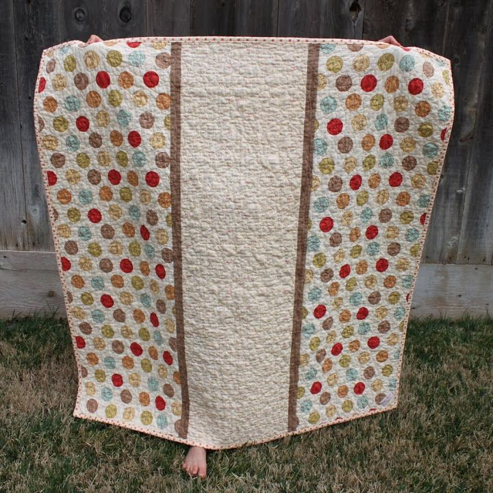 This is the back of the quilt I made from the Whimsy collection of fabric by Moda. The large dot fabric is called Vintage Flash Cards in Milk. Wish I'd bought more of it!