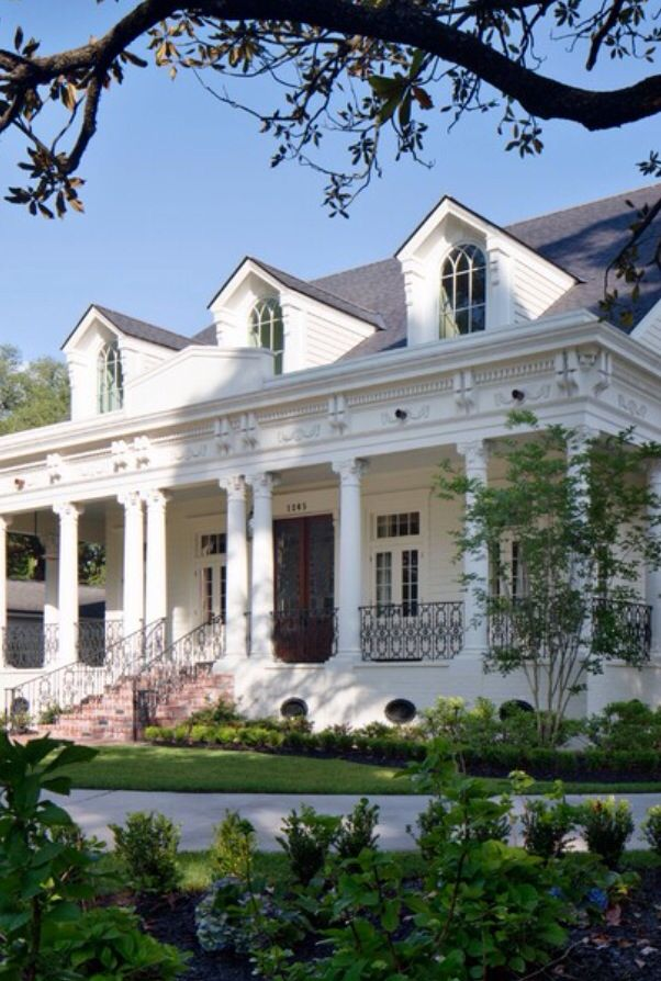 Love this raised cottage with Corinthian columns and