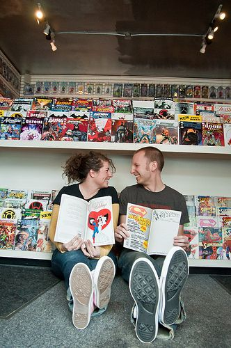comic book store engagement pictures. #milwaukee #engagement #photography #vintage #comics
