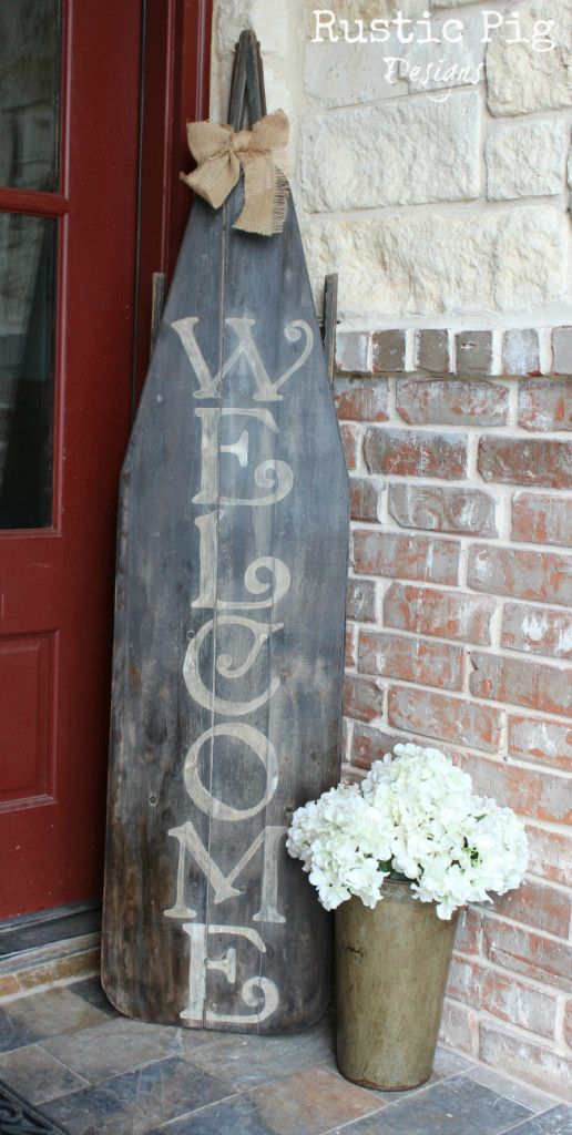 """Love this for the front porch. Maybe a tad smaller """"Welcome"""" sign, but still love the idea with the antique jug with white flowers."""