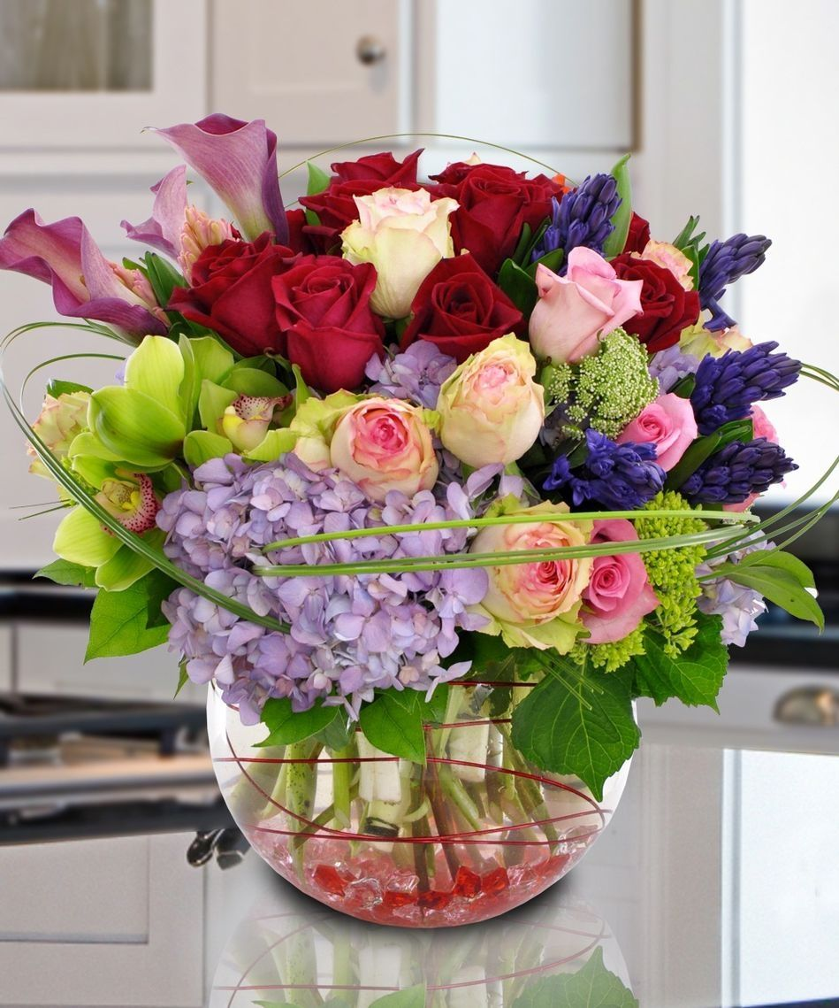 This vase is filled with a wide assortment of premium flowers purchase the stunning rhapsody bouquet at carithers flowers of atlanta we offer nationwide same day flower delivery service izmirmasajfo Gallery