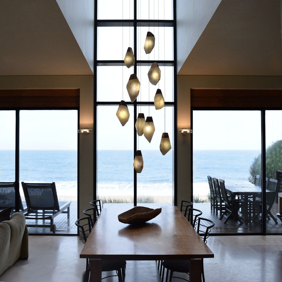 Hand carved alabaster pendant lights by artist and designer randy hand carved alabaster pendant lights by artist and designer randy zieber aloadofball Choice Image