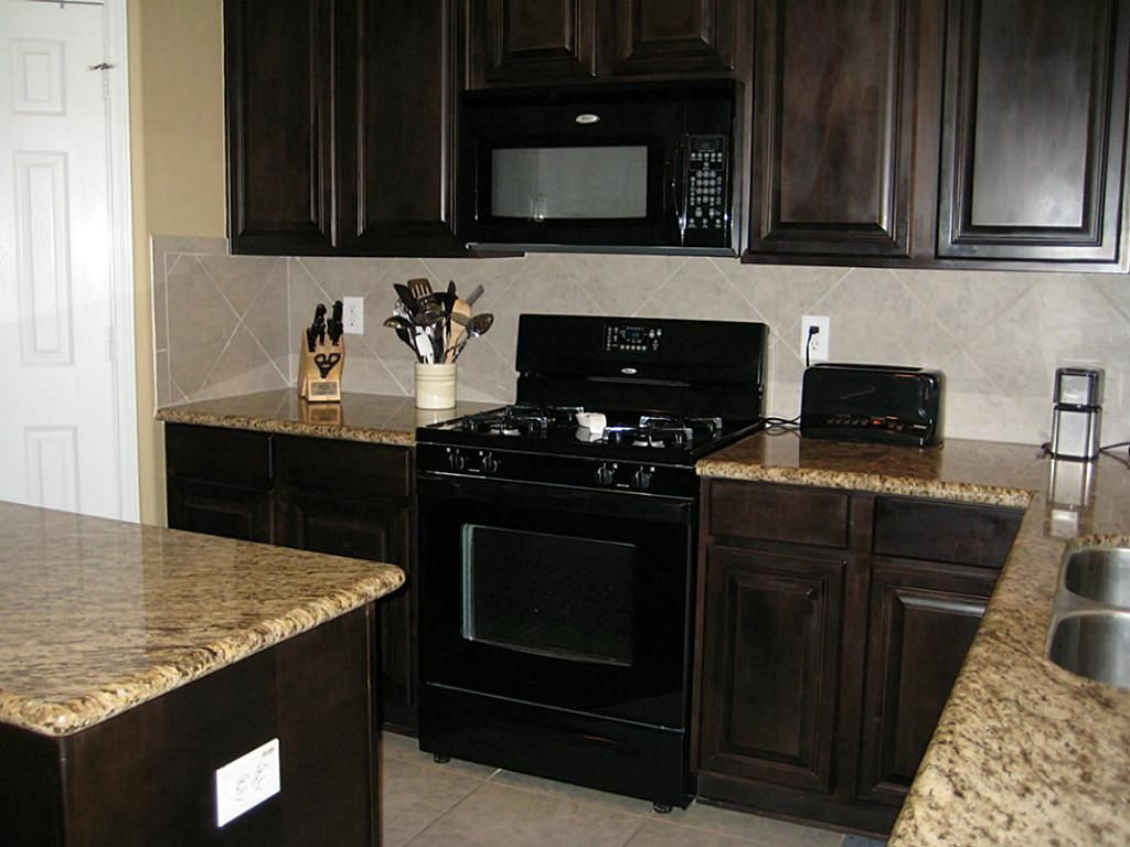 Black appliances with java cabinets kitchen pinterest for Dark oak kitchen cabinets