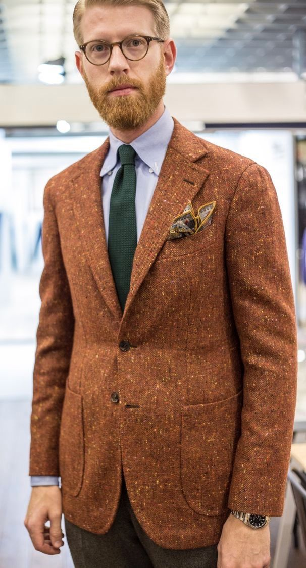Drake's Diary with a dapper combo featuring a burnt orange speckled blazer  blue button collar shirt green textured tie multi colored pock…  fe0df92323f0