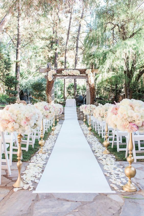 Beautifully Lined Aisle With Ivory Rose Petals And Tall Fl Arrangements
