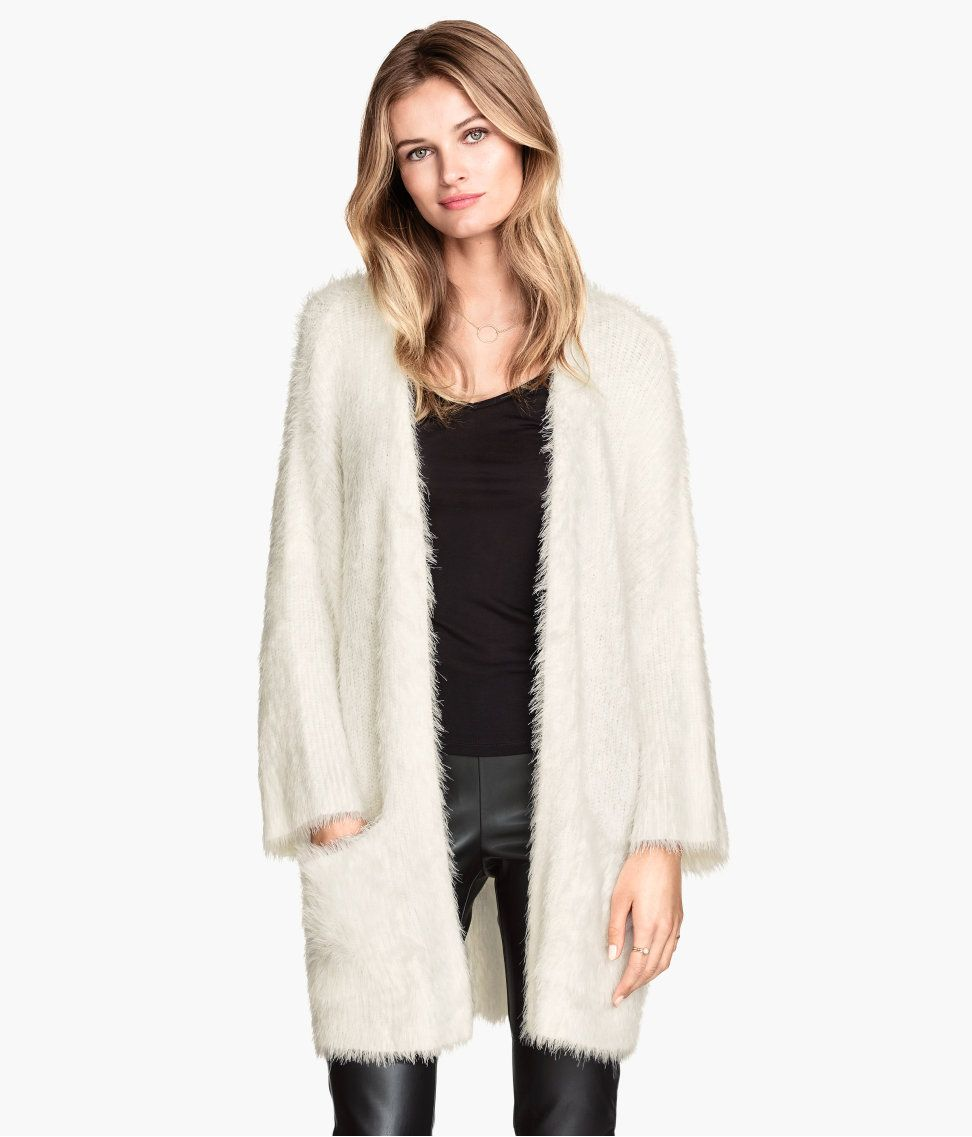 Cozy white cardigan in soft, fluffy yarn. Front pockets & 3/4 ...