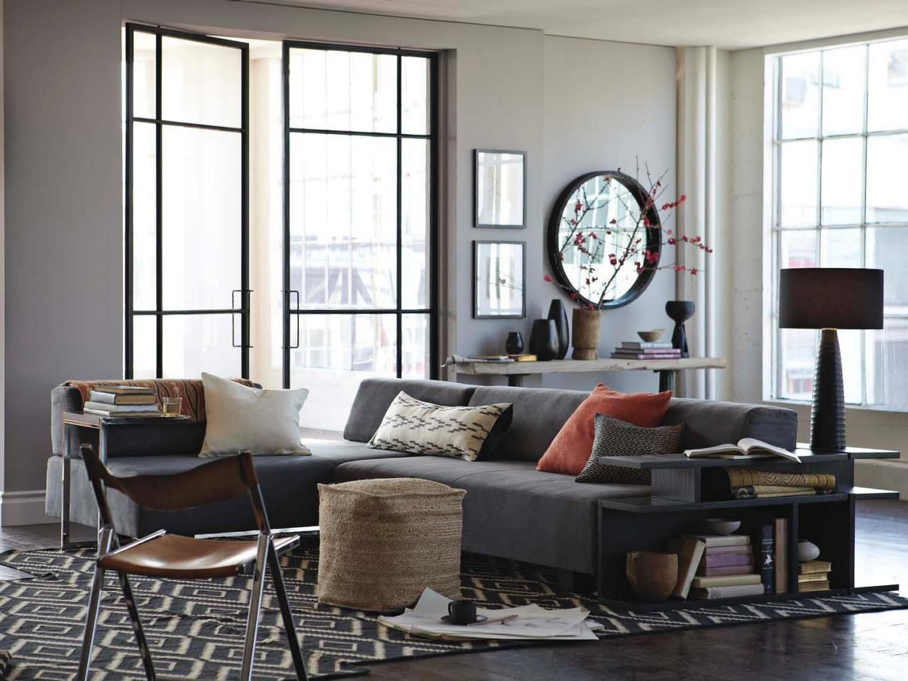 This Bright Living Room Boasts A Modern Take On Traditional French Doors And Contemporary Sectional