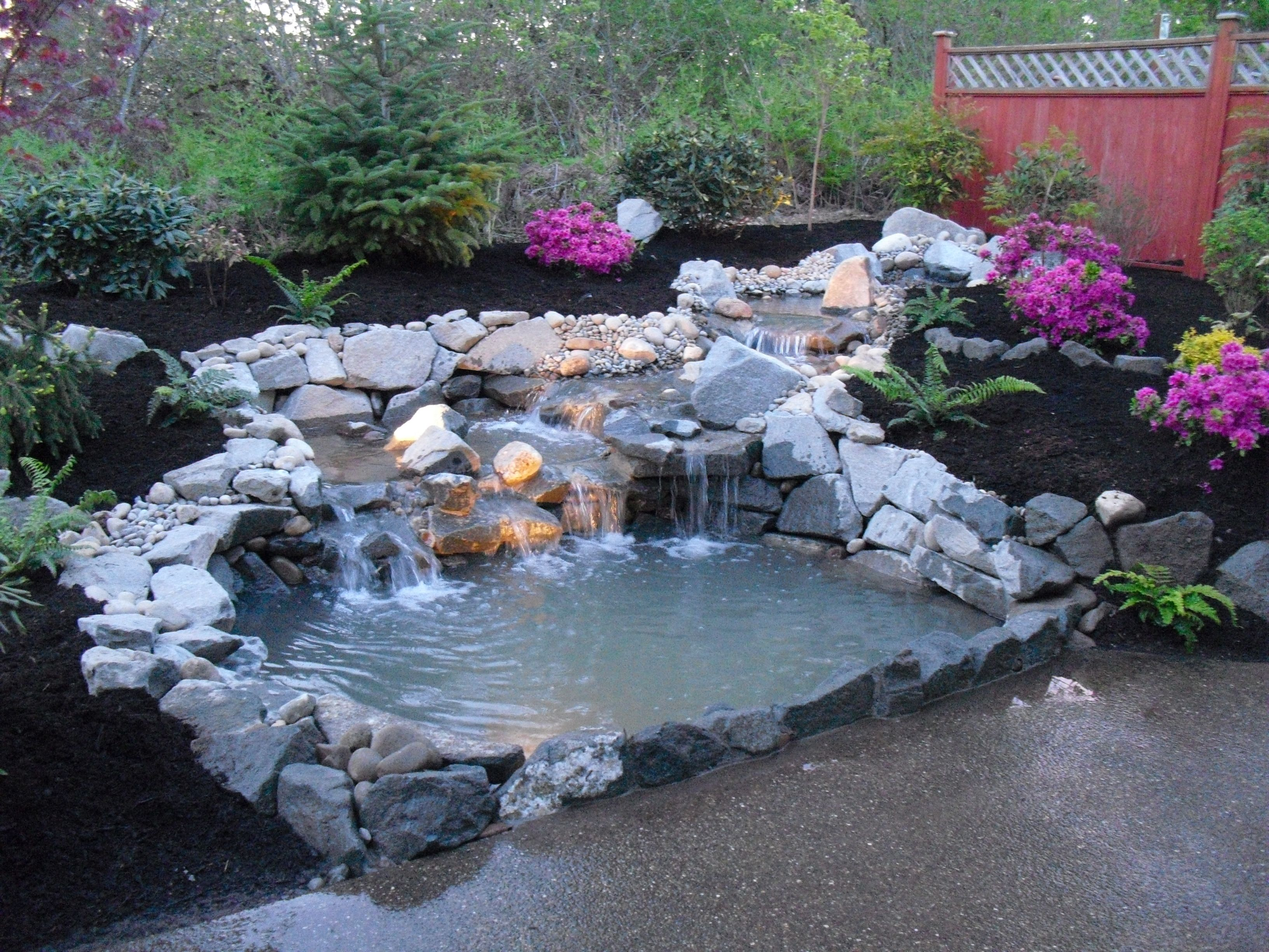 Traditional home page 2 home garden design ideas with for Fish pond waterfall ideas