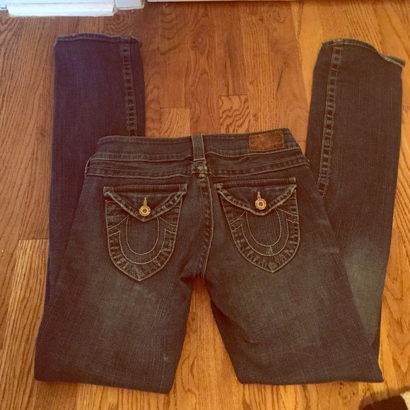 True Religion boot cut jeans These True Religion jeans are lightly worn dark wash with golden stitching. They have button enclosures on back pockets and are in great condition! True Religion Pants Boot Cut & Flare