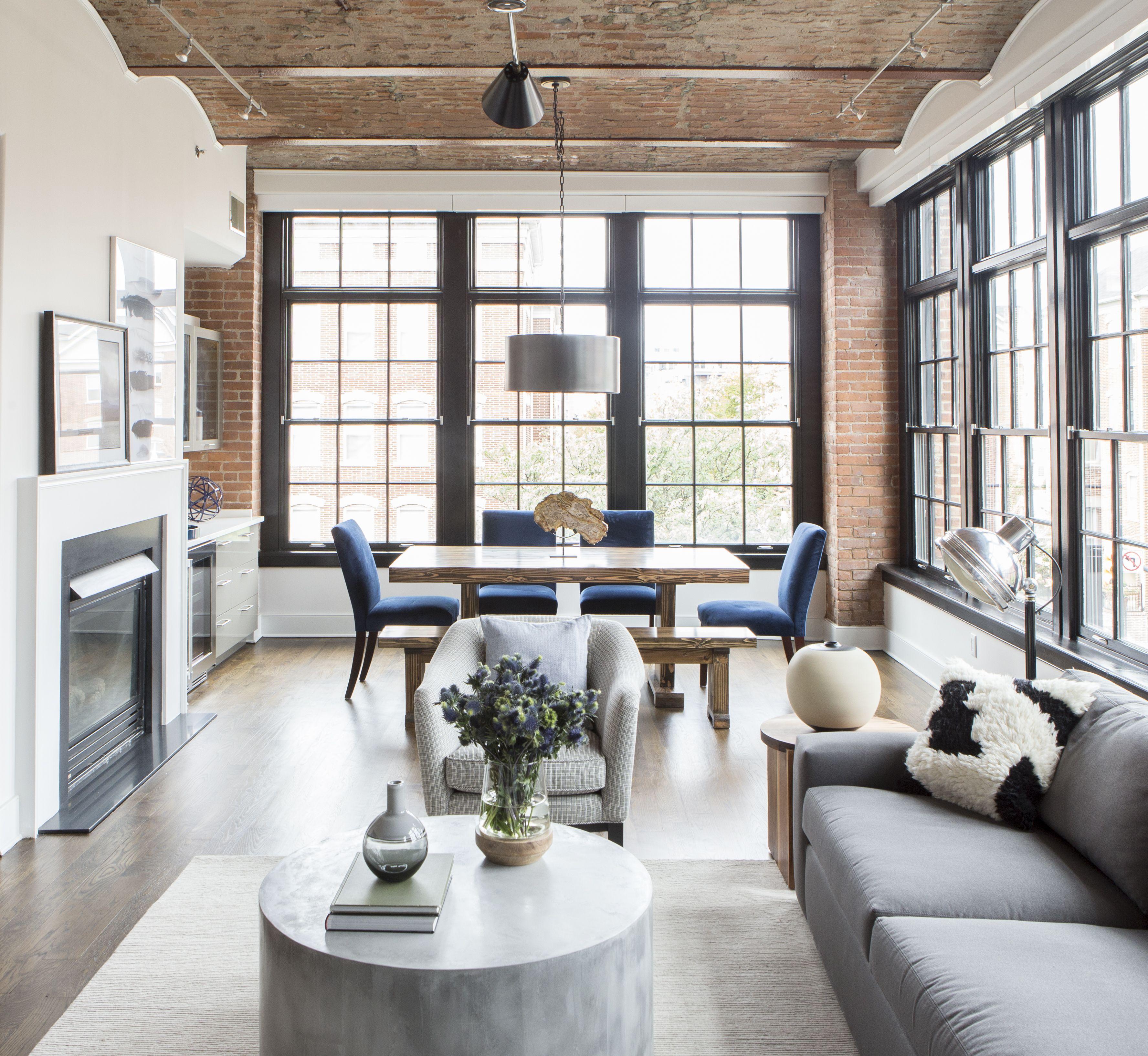 Industrial modern loft with brick arch ceiling black window trim