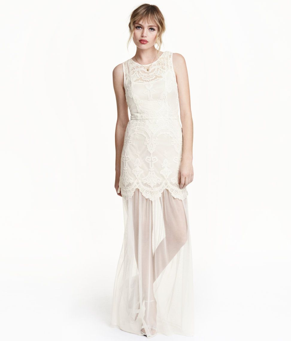 sleeveless embroidered tulle dress with a visible metal zip at