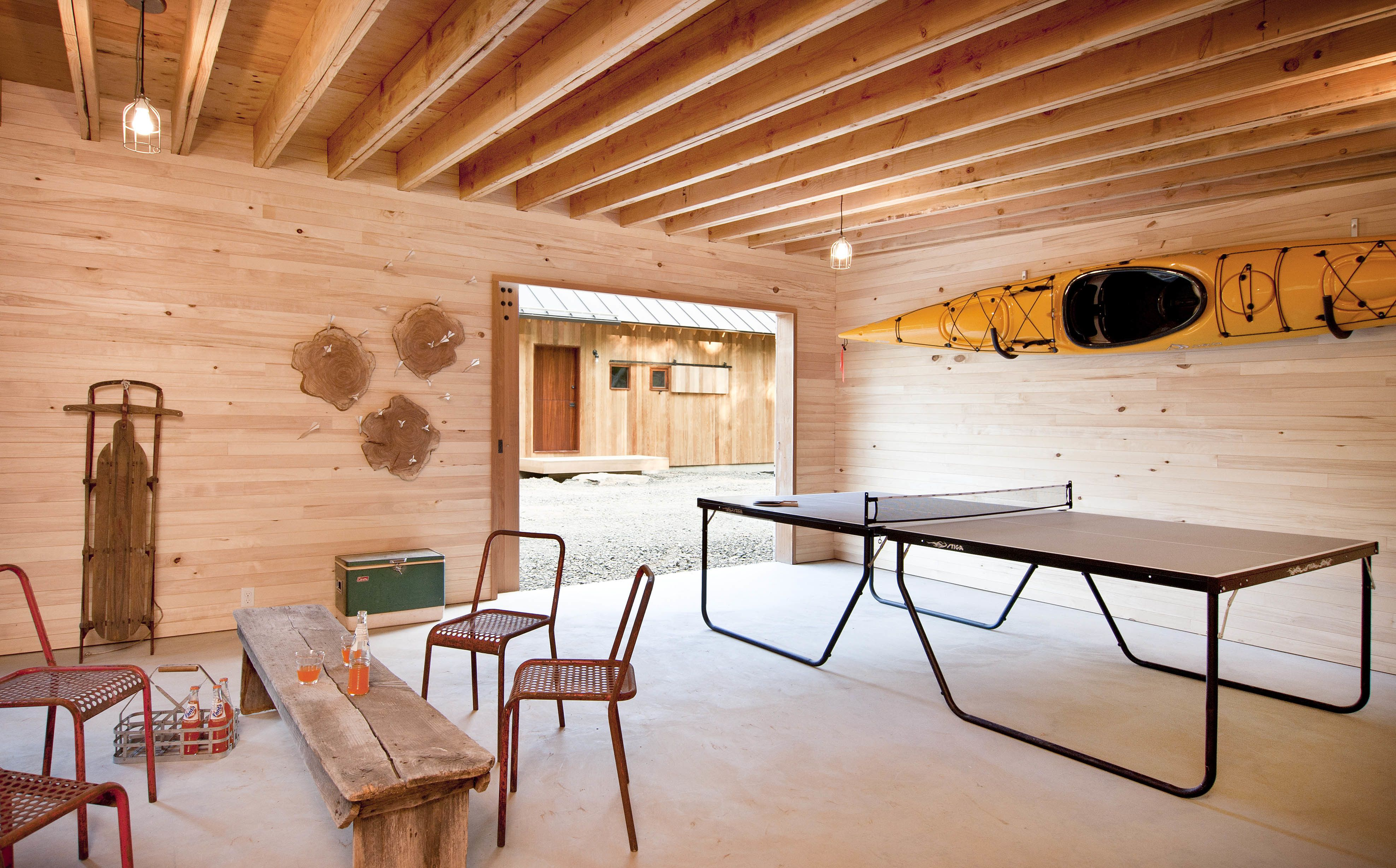"""The Langs use an outbuilding as a rec room of sorts. """"We call that the Grace Studio,"""" Lang says. """"It's designed so a car can pull in there, but we use it as more of a rec room and work space."""""""