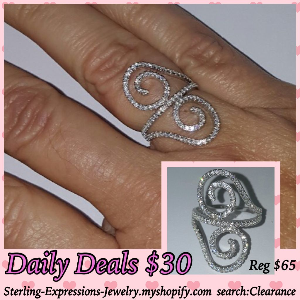 Stunning micro pave hand-set cubic zirconias in a swirl sterling silver setting.  Such a fun ring to wear - buy 2 and give one to your bestie!!!  Reg. $65  Clearance Close-out!