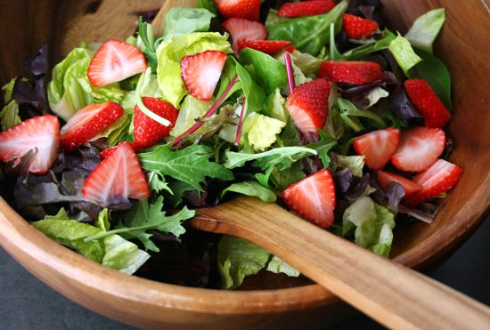 mixed greens salad with strawberries and candied almonds