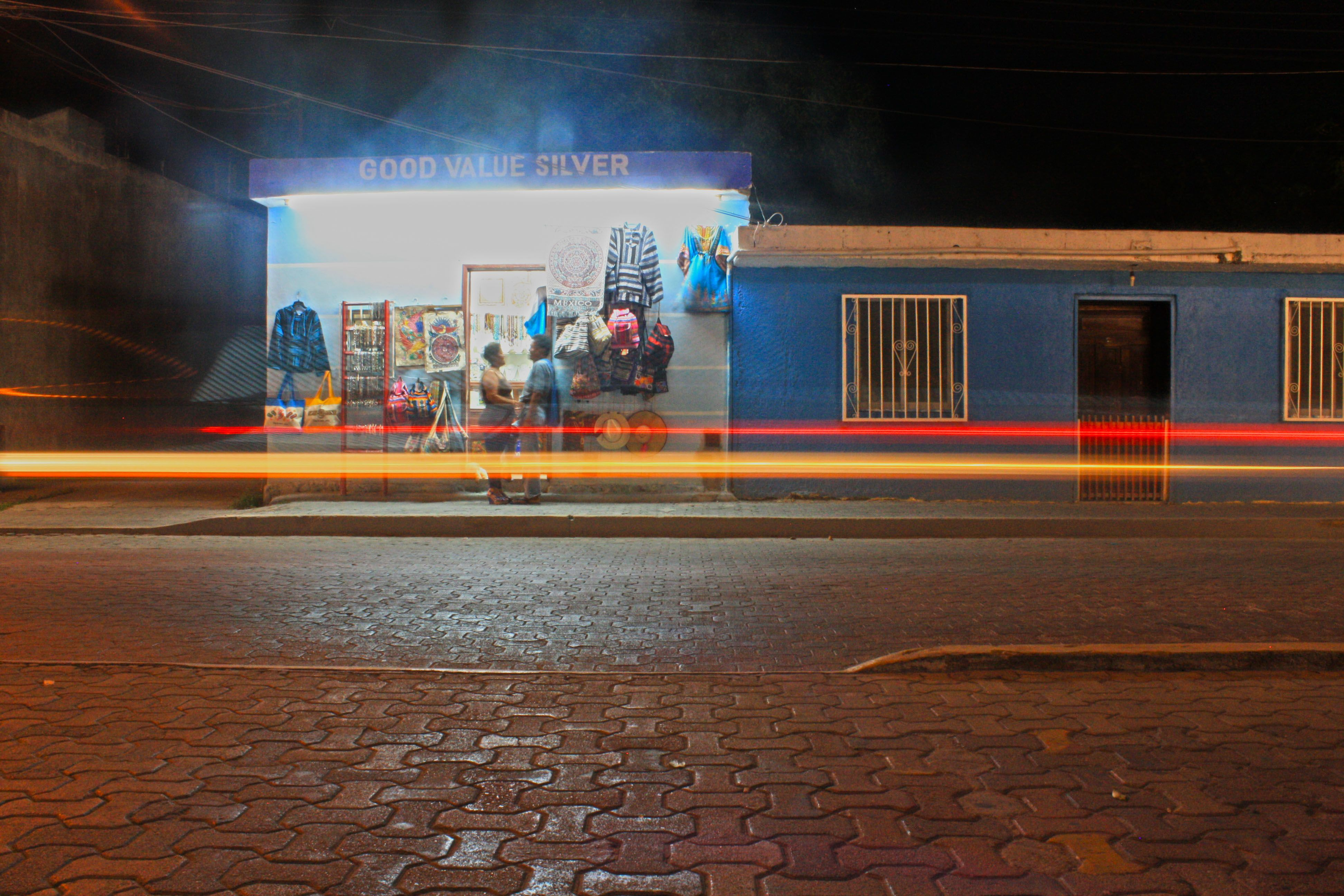 4 second exposure on a scooter intruding on a romantic mexican moment