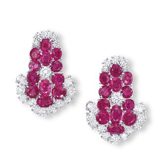 A PAIR OF RUBY AND DIAMOND EAR CLIPS, BY BULGARI Each designed as a cascade of oval, circular and cushion-shaped rubies, enhanced by brilliant-cut diamonds, mounted in platinum and 18k white gold, circa 1960s | Christie's