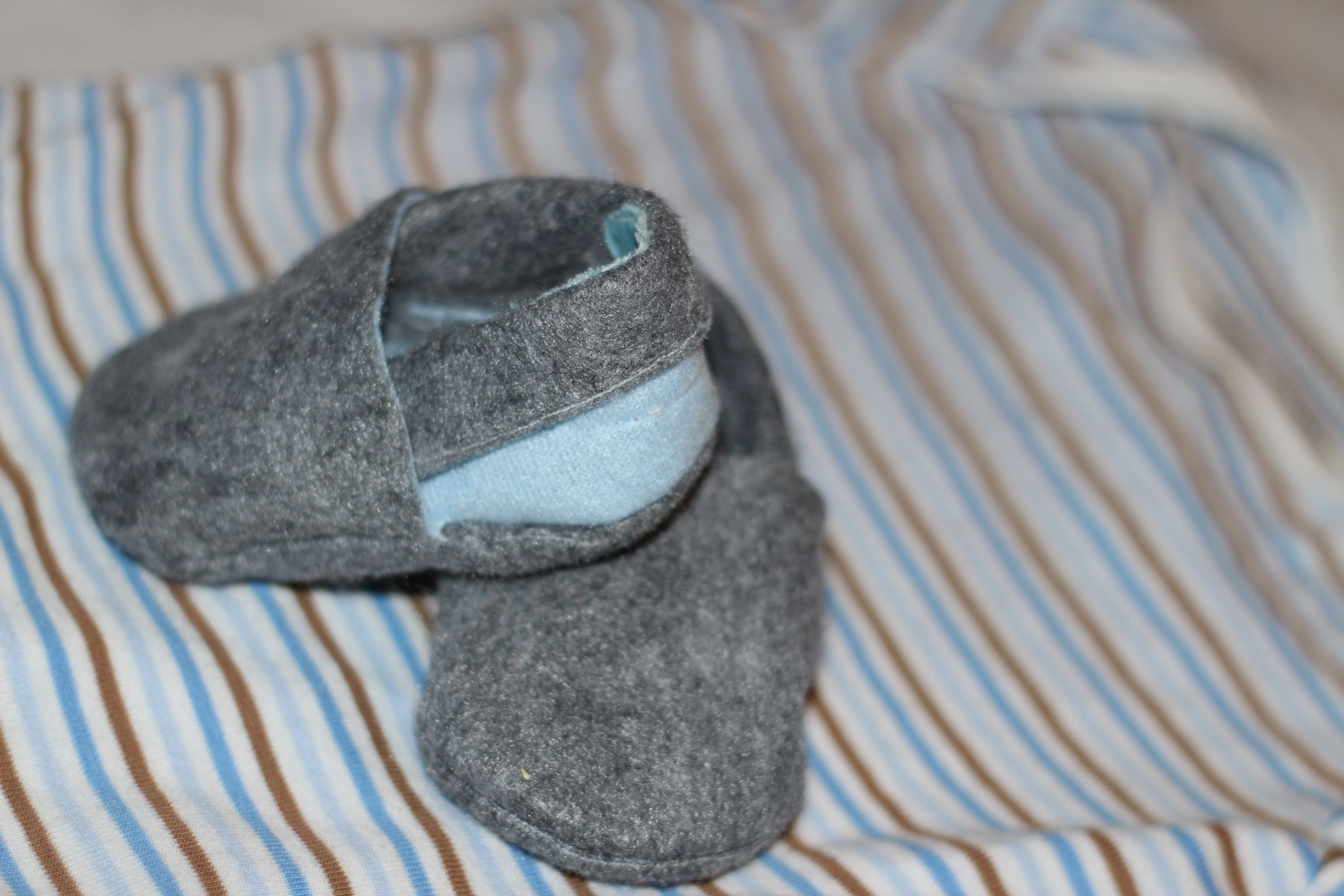 Add a bit of personalization to a store bought baby gift? Make a pair of baby shoes that will 'go' with your purchase! Lots of tutorials here on Pinterest- that is we're i found this one. Baby blue & grey turned out adorable!