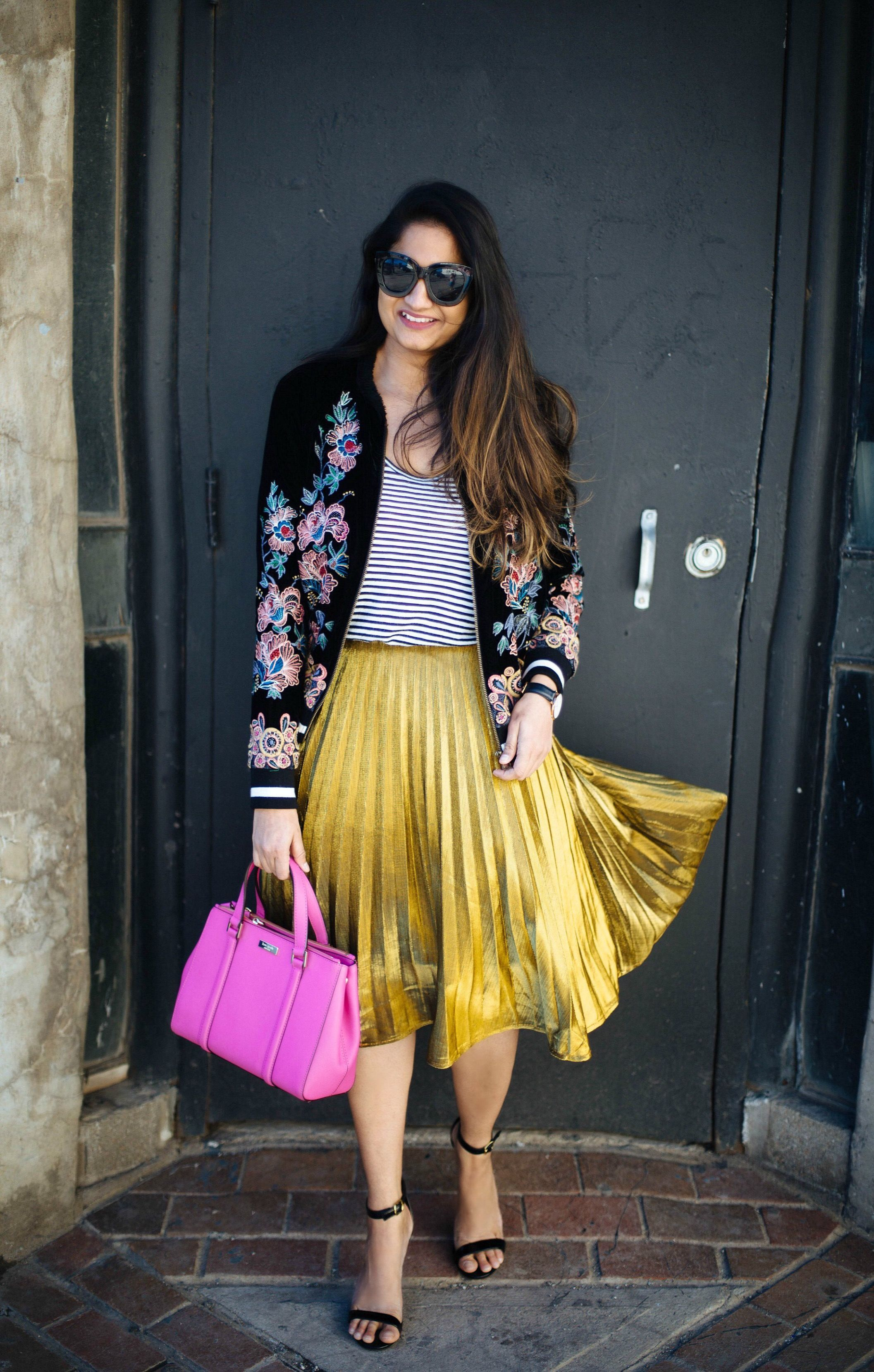 640b62f20b 2 ways to a dress up a gold pleated skirt, how to style a gold pleated skirt,  shin pleated yellow skirt, floral embroidery bomber jacket, spring outfits,  ...