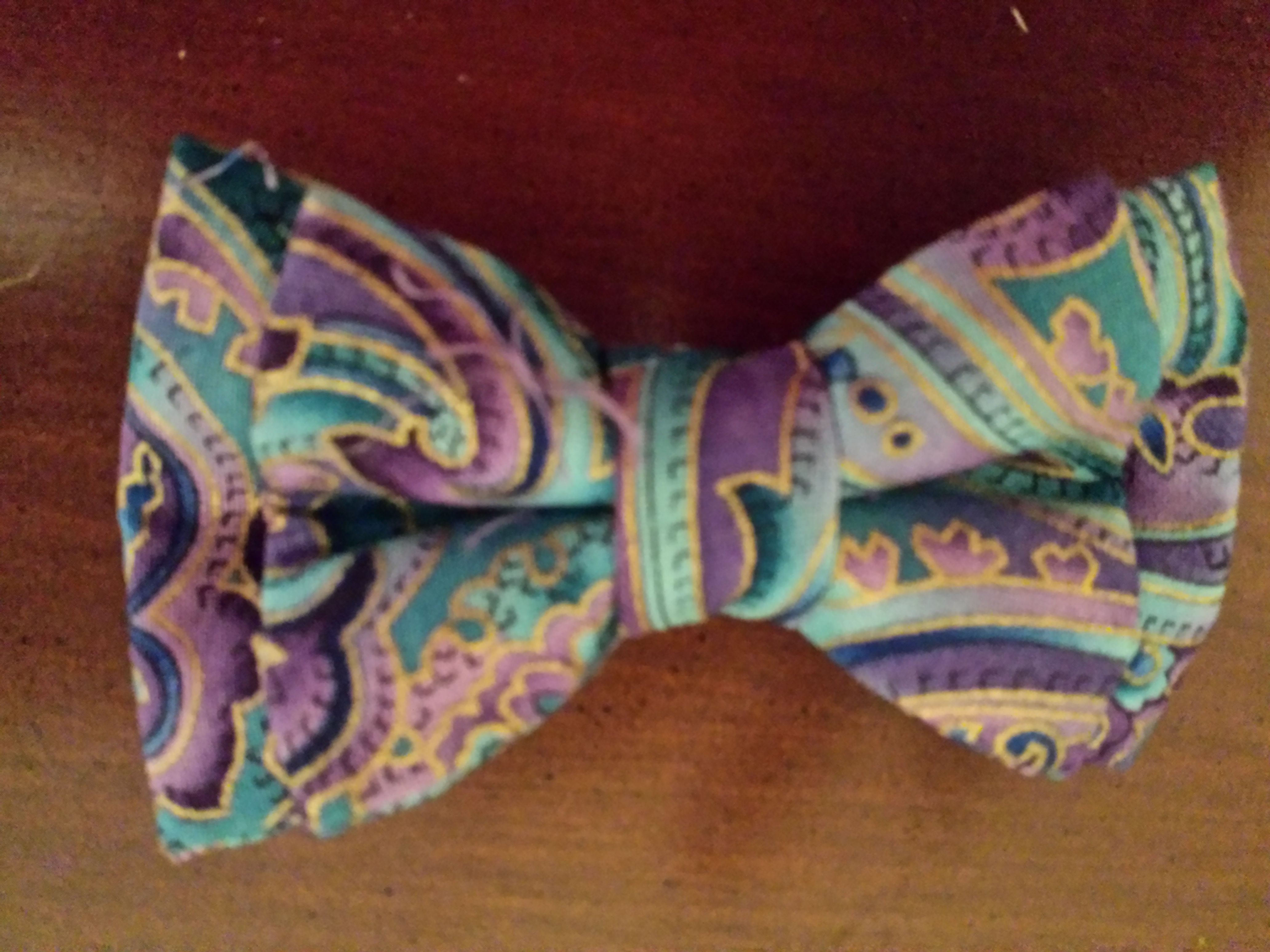 Purple and blue paisley print. $10.00