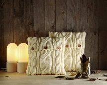 Milky white cable knit pillow cover with 3 wooden buttons.