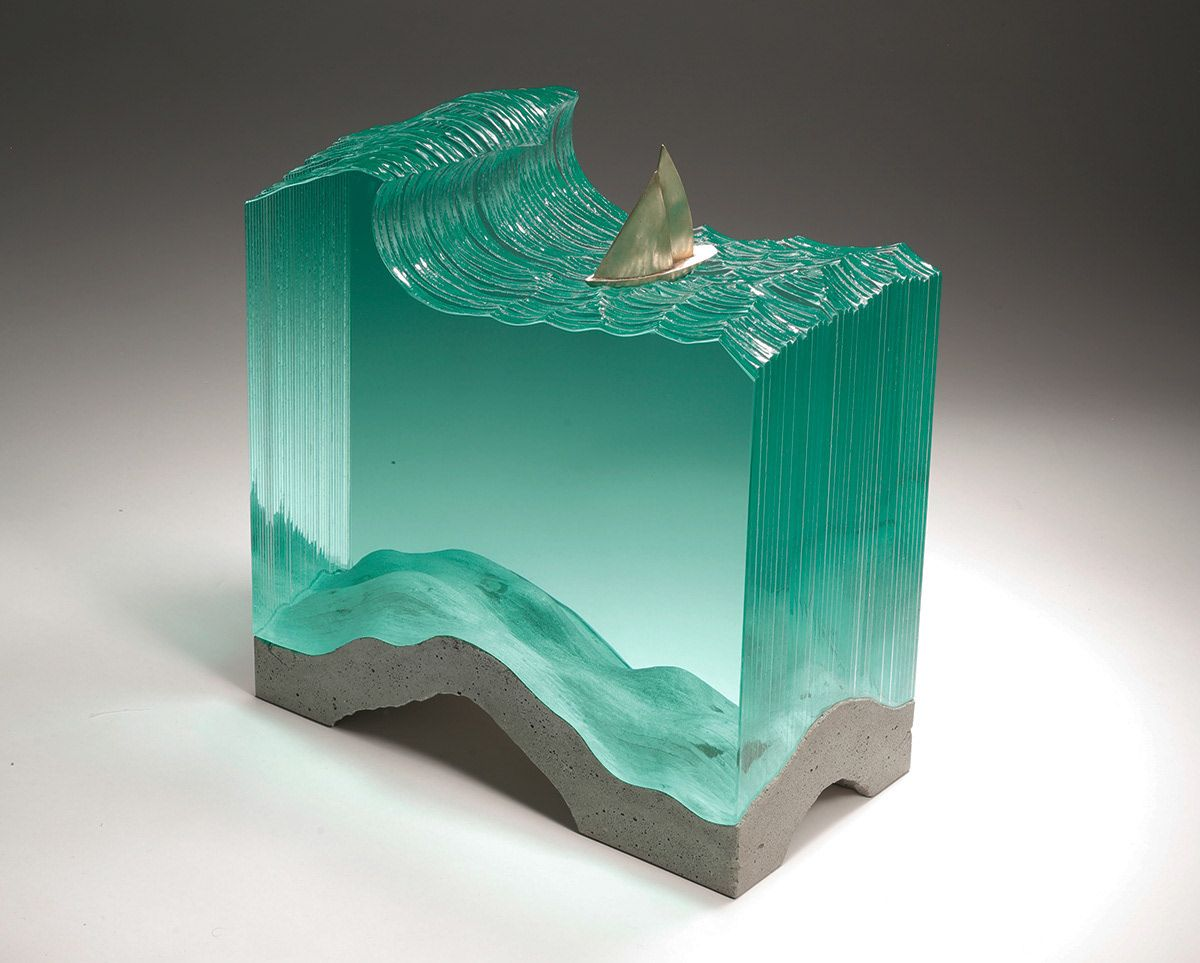 Laminated clear float glass with cast concrete and bronze ...