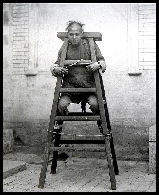 A convict on the ladder-like contraption. Their shins would have been digging into the edge of the cross board every time they allowed their body to relax. And they wouldn't have been able to sit or stand but would've been forced to stay in that uncomfortable, hunched position for as long as the punishment dictated.