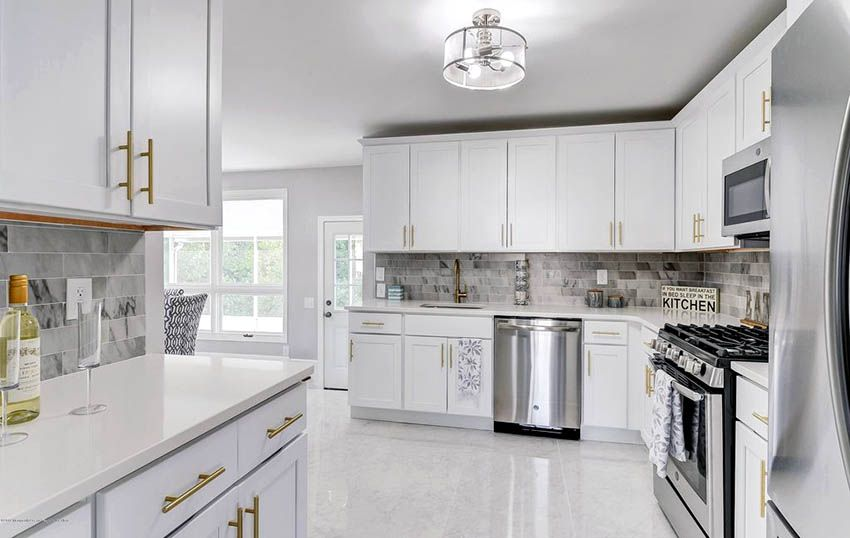 White Cabinet Kitchen With Marble Tile Floors And Marble Backsplash White Marble Kitchen Marble Floor Kitchen Kitchen Marble