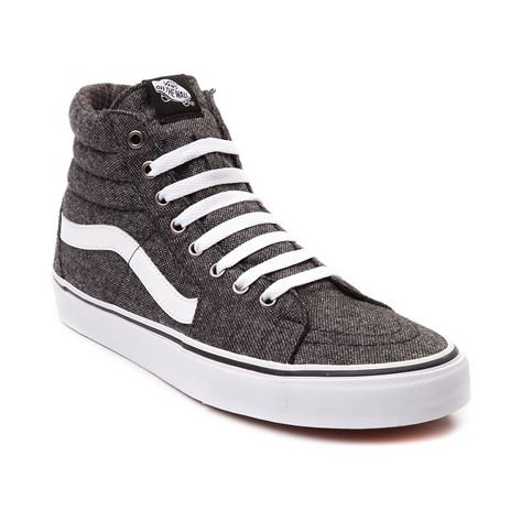 Pave the way for skate style with the new Sk8 Hi Tweed Skate Shoe from Vans! The Sk8 Hi Tweed Skate Shoe sports a classic hi-top design with handsome tweed uppers and signature leather side stripe. Available only online at Journeys.com! Features include Tweed upper with textile plaid lining Vans signature side stripe Lace closure offers a secure fit Padded tongue and collar provide stability and comfort Vulcanized rubber outsole with signature waffle tread delivers flexible trac...