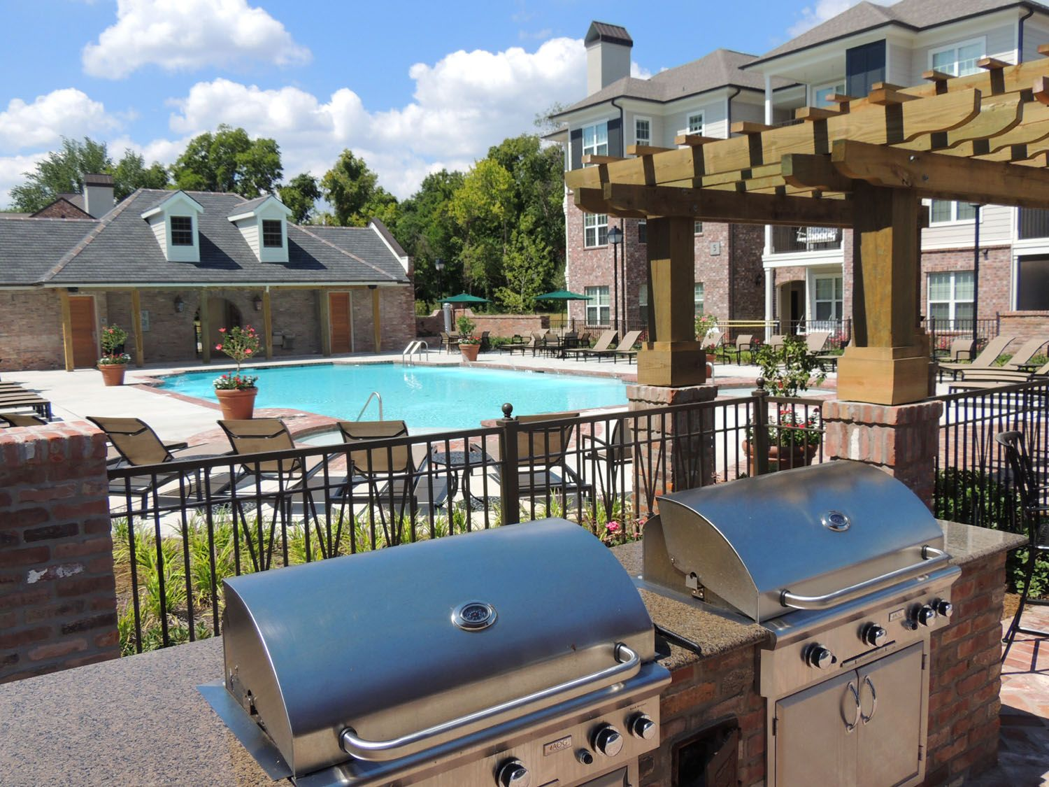 Coates Bluff outdoor cooking area by pool Coates Bluff Luxury