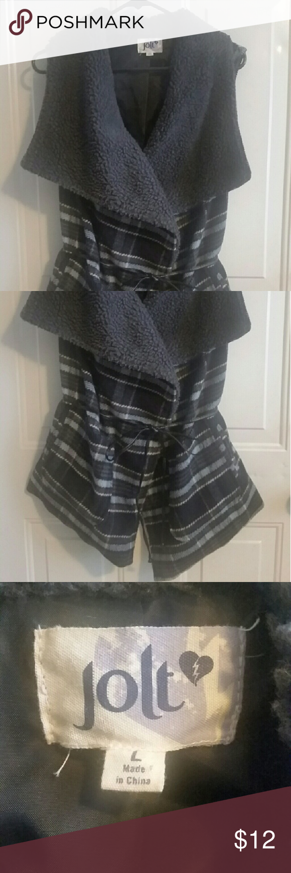 Plaid Vest for Autumn I love this and would possibly wear it everyday in the Fall, but I'm really, really trying to minimize to bare essentials!  I plan on moving to a tiny house once my kids are gone. :-)  You can wear this tied, or open and leave the little belt tied in the back.  It's very cozy and warm. Excellent condition.  Size is L, but it could easily fit anywhere from a 6-14 more than likely. Colors are gray and blue and brown, with some white/cream. Jolt Jackets & Coats Vests