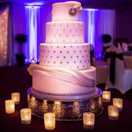 Bling wedding cake with a wrap around draping