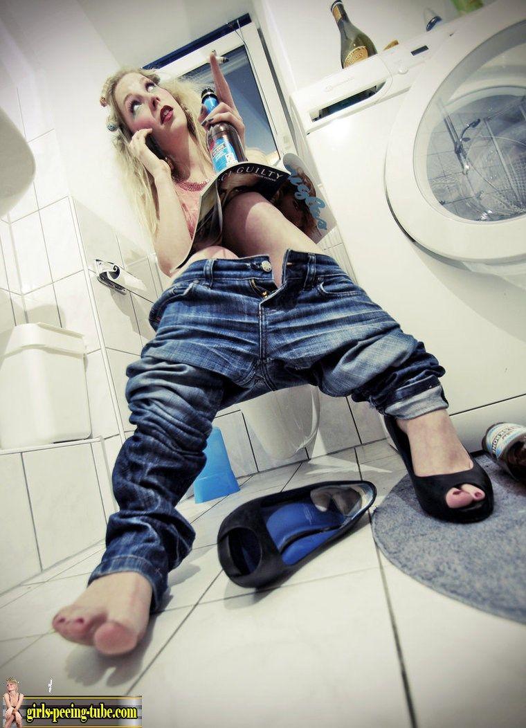 nice girl  pissing in her  toilet