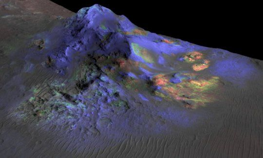 Deposits of impact glass have been preserved in Martian craters, including Alga Crater, shown here. Detection of the impact glass by researchers at Brown University, Providence, R.I., is based on data from the Compact Reconnaissance Imaging Spectrometer for Mars (CRISM) on NASA's Mars Reconnaissance Orbiter. In color coding based on analysis of CRISM spectra, green indicates the presence of glass. (Blues are pyroxene; reds are olivine.) Credit:Courtesy of NASA/JPL-Caltech/JHUAPL/University…