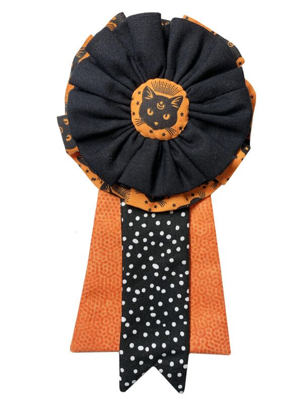 DIY Award Rosette Ribbons These ribbon rosettes are a great way to make someone feel special, or to decorate a package. They go together easily and quickly. Simply change the color and style of the fabrics, and you have a lovely hand-made gift that is way spiffier than store-bought versions.