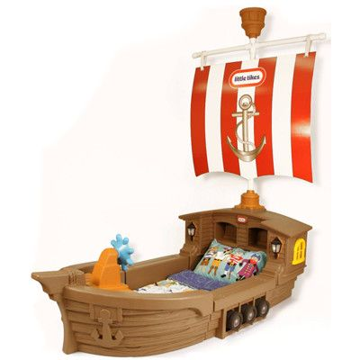 As your little one drifts off to sleep, they'll dream of adventure on the high seas in this enchanting pirate ship toddler bed from Little Tikes. It features a built-in toy box with a detachable lid, cubby holesforsmall items like books or a clock and 2 working night-lights with auto shut-off.
