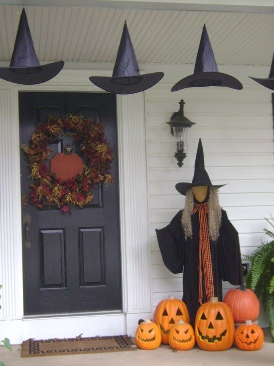 spooky styles decorating porch and entryway halloween ideas unusual hanging hats for front porch halloween decor completed with the black witch with
