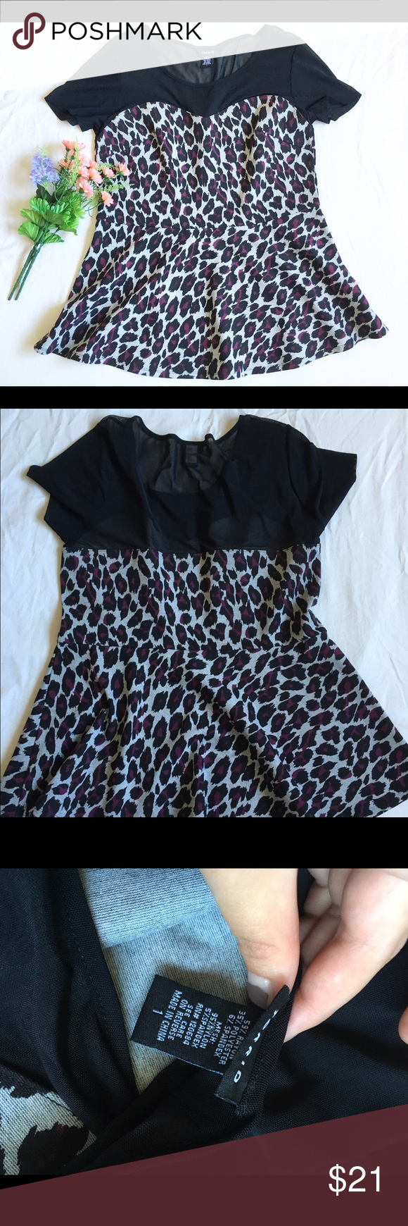 Torrid1 leopard peplum top Torrid1 leopard peplum top. Pull over peplum top with heart shape bust and mesh collar. torrid Tops