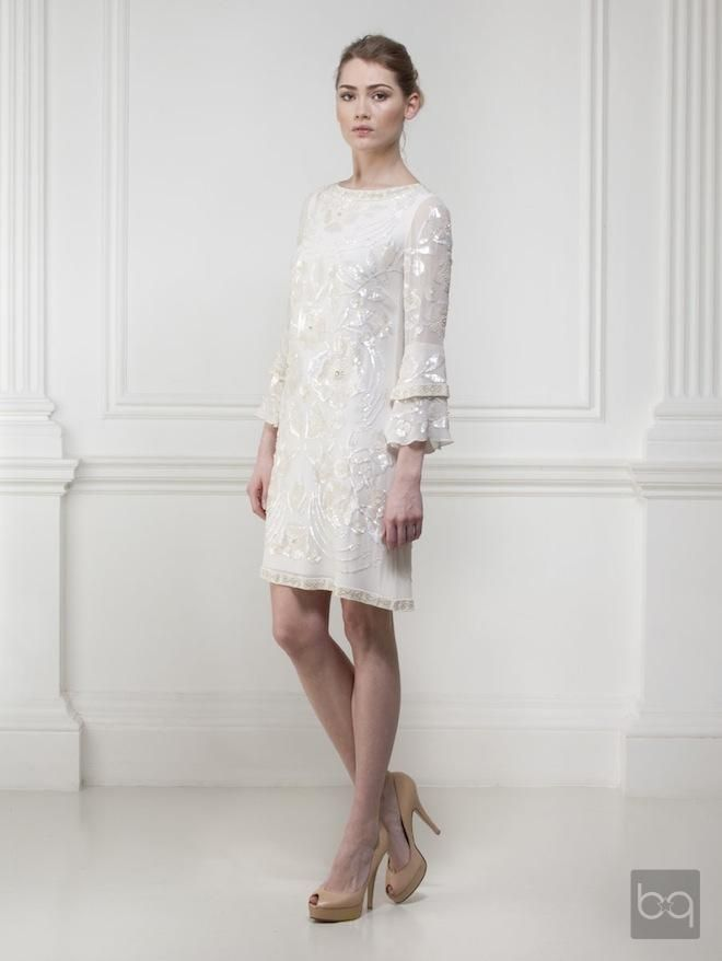 My dream wedding dress... Short, long sleves... Everything I want in ...