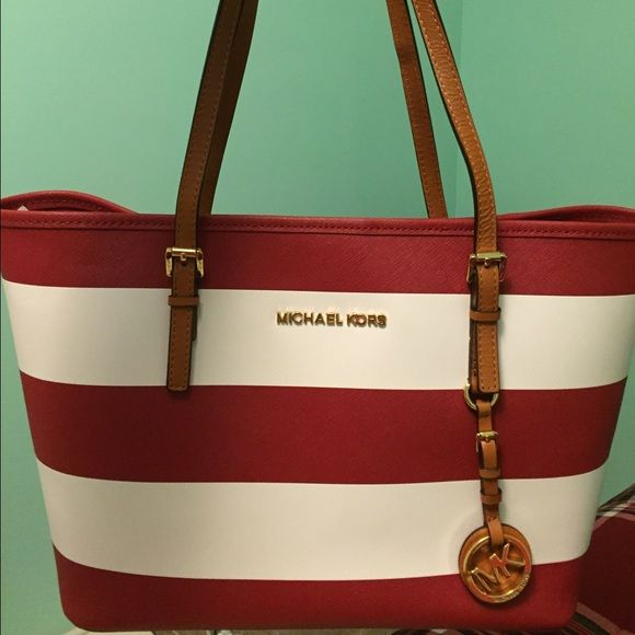 Michael Kors red and white striped tote bag New without tags Michael Kors tote bag. Very cute nautical stripes! Perfect for the beach or anywhere. Please make an offer if interested. Prices will not be discussed via comments. Thank you! Michael Kors Bags Totes