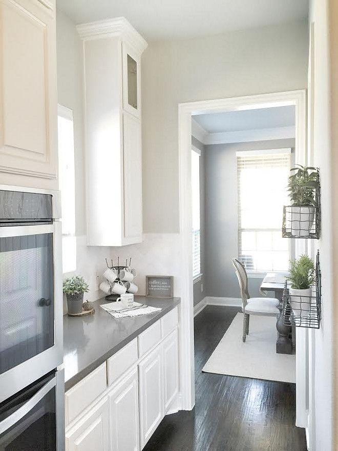 White cabinet against very dark hardwood floors. Floors ...