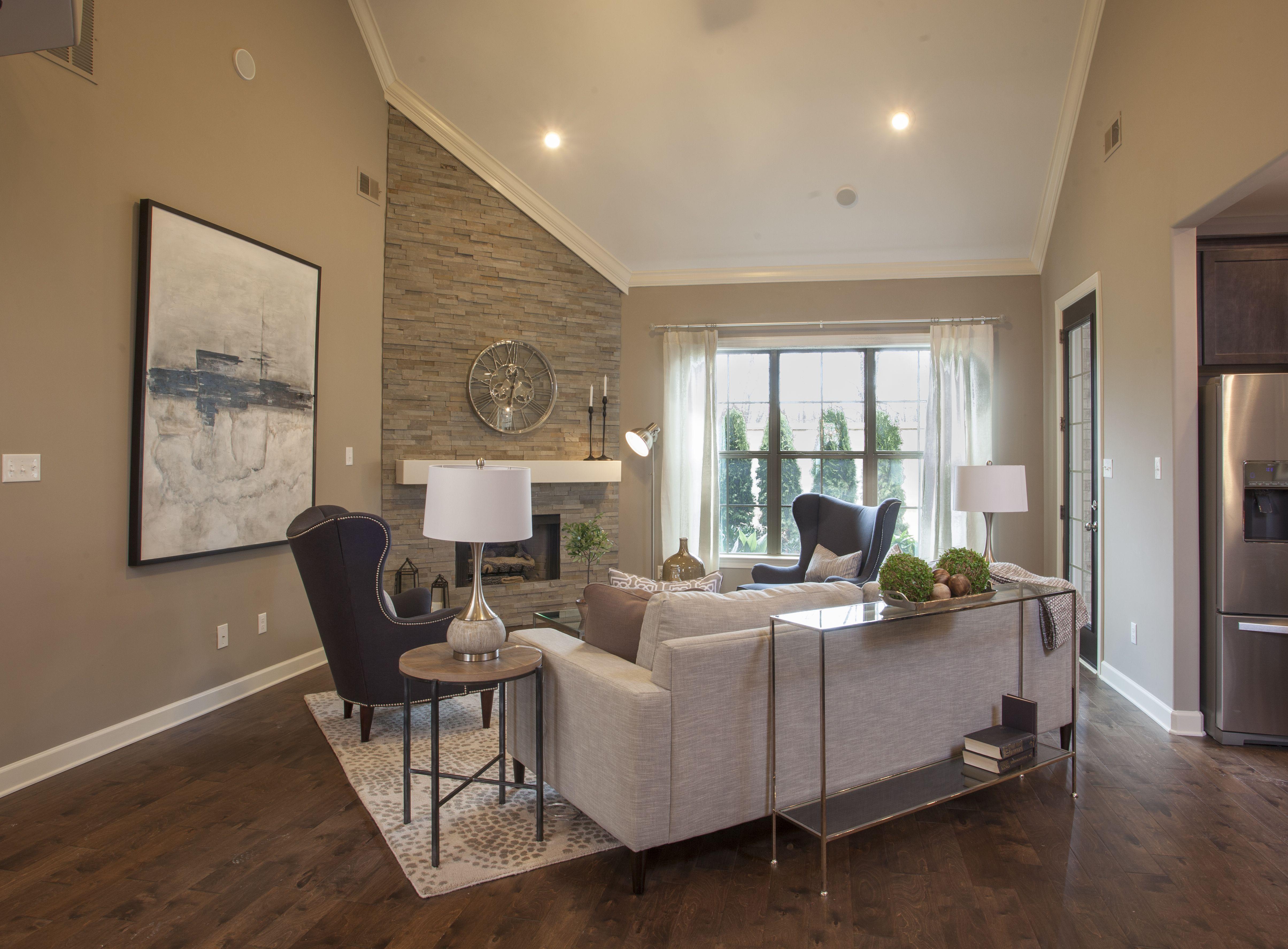 Regency homebuilders great room vaulted ceiling stone for Vaulted ceiling great room