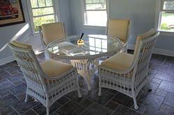 Like New Ethan Allen Wicker Dining Set. This set has rarely been used. It's showroom quality for sure! $2,500. www.shopinteriorexchange.com